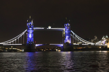 london tower bridge: LONDON, UNITED KINGDOM - SEPTEMBER 11 2015: London Tower bridge at night by the river Thames, lighted in Blue