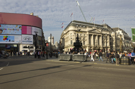piccadilly: LONDON, UNITED KINGDOM - SEPTEMBER 11 2015: Overview of Piccadilly Circus square at Day time, with Ripleys building and famous neon signs Editorial