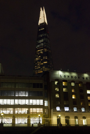 shard: LONDON, UNITED KINGDOM - SEPTEMBER 11 2015: Night view of London Bridge Hospital with the Shard Pyramid building in the background
