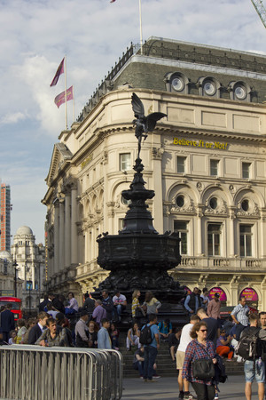 shaftesbury: LONDON, UNITED KINGDOM - SEPTEMBER 11 2015: Shaftesbury Memorial Fountain in Piccadilly Circus square in London, with people around and Ripleys building behind