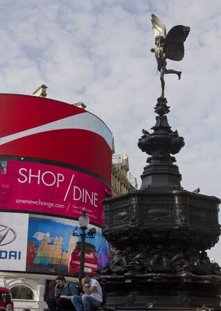 shaftesbury: LONDON, UNITED KINGDOM - SEPTEMBER 11 2015: Architectural close up of he Shaftesbury Memorial Fountain in Piccadilly Circus in London, with famous led signs in the background