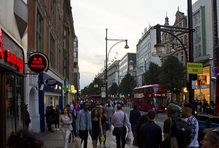 oxford street: LONDON, UNITED KINGDOM - SEPTEMBER 11 2015: People around Oxford Street in London at sunset time, with all London shops Editorial