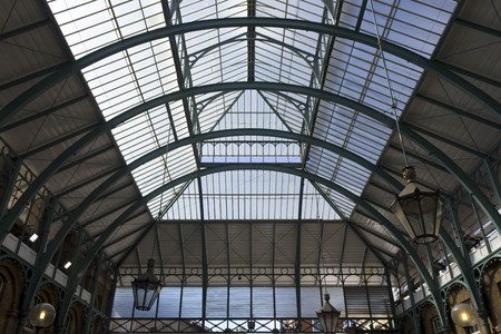 covent: LONDON, UNITED KINGDOM - SEPTEMBER 12 2015: Architectural close up of glazed roof of Covent Garden Market in London Editorial