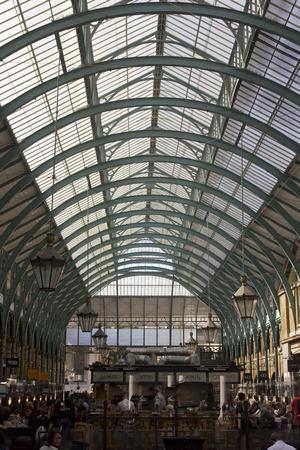 covent: LONDON, UNITED KINGDOM - SEPTEMBER 12 2015: People in Covent Market covered roof in London, United Kingdom