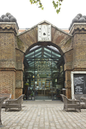arsenal: LONDON, UNITED KINGDOM - SEPTEMBER 13 2015: Entrance of the London historic pub Dial Arch, in Woolwich Arsenal riverside