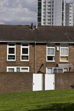 periphery: LONDON, UNITED KINGDOM - SEPTEMBER 12 2015: Row of British brick house in the periphery of London