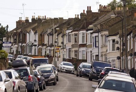 bow window: LONDON, UNITED KINGDOM - SEPTEMBER 12 2016: Traditional british houses in a row with car parked on the street, in the suburb of Woolwich Arsenal, London