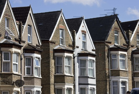 bow window: LONDON, UNITED KINGDOM - SEPTEMBER 12 2015: Traditional English terraced house in a row, in Woolwich Arsenal London district