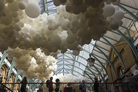 covent garden market: LONDON, UNITED KINGDOM - SEPTEMBER 12 2015: Heartbeat balloon installation in London Covent Garden market, with people around Editorial