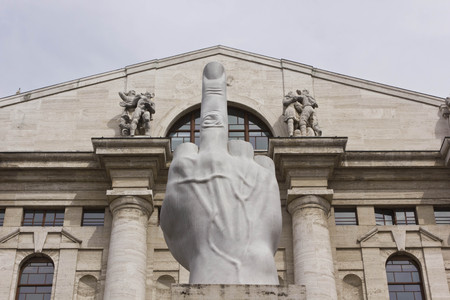 MILAN, ITALY - APRIL 16 2015: Close up of the controversial sculpture L.O.V.E. by Italian Maurizio Cattelan in front of stock exchange building in Piazza Affari, Milan