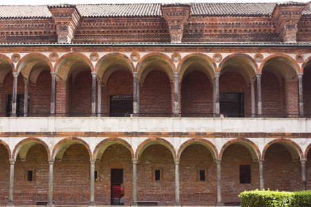 MILAN, ITALY - APRIL 14 2015: Frontal view of the facade of the Lavatory Cloister at Historic State Univeristy of Milan, Italy