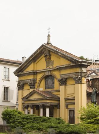 colonnade: MILAN, ITALY - APRIL 16 2015: Outdoor view of Santa Maria Podone church in Milan, with its garden