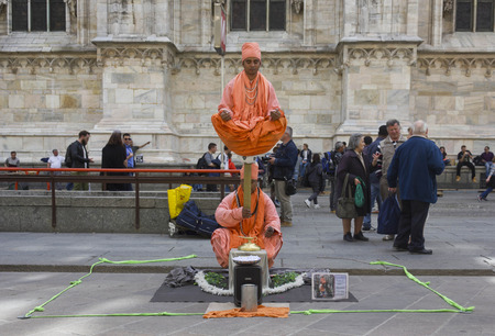 balancing act: MILAN, ITALY - APRIL 14 2015: Unknown street artists in Milan city center, performing a balancing act Editorial