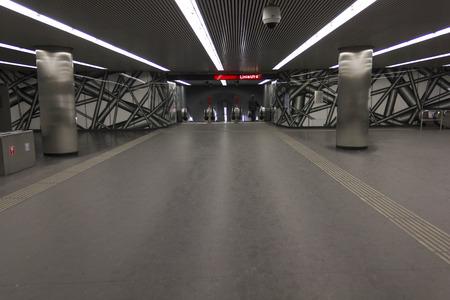 u bahn: VIENNA, AUSTRIA - JANUARY 2 2016: Vienna undergound station, U1 red line, with just one person in the background