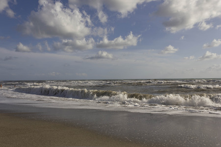 MARINA DI MASSA, ITALY - AUGUST 17 2015: Panoramic view of the Versilia shoreline in a summer rough sea day, nobody around