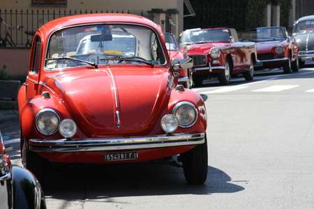 LASTRA A SIGNA, ITALY - AUGUST 30 2015: Vintage red beetle parked on the street in Lastra a Signa, Florence Редакционное