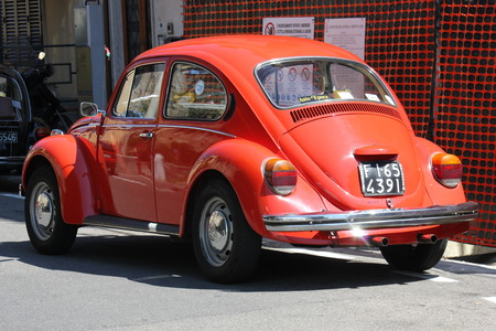 LASTRA A SIGNA, ITALY - AUGUST 30 2015: Vintage red beetle parked on the street in Lastra a Signa, Florence Editorial