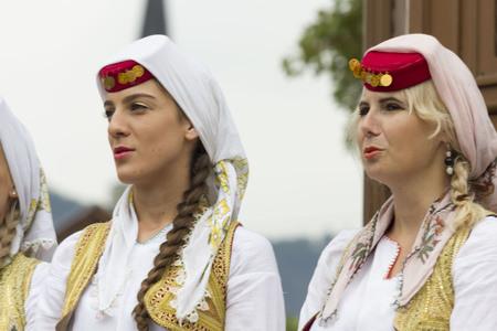 SARAJEVO, BOSNIA AND HERZEGOVINA - AUGUST 20 2017: Two bosnian girls traditionally dressed in sarajevo