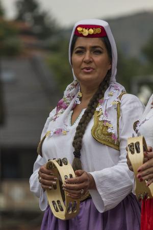 SARAJEVO, BOSNIA AND HERZEGOVINA - AUGUST 20 2017: Portrait of a traditionally dressed Bosnian musician