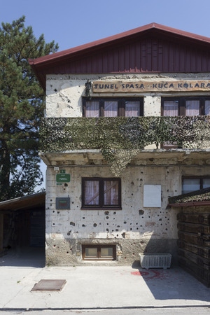 SARAJEVO, BOSNIA AND HERZEGOVINA - AUGUST 19 2017: Damaged facaded of the Tunnel Museum of Sarajevo, constructed by the besieged citizens of Sarajevo during the war