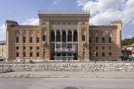 SARAJEVO, BOSNIA AND HERZEGOVINA - AUGUST 18 2017: Main facade of Sarajevo City Hall building, known as Vijecnica 에디토리얼