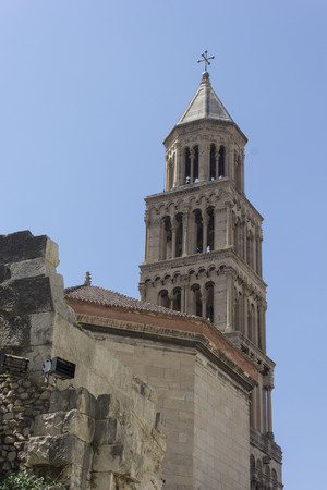 SPLIT, CROATIA - AUGUST 11 2017: Bell tower of Saint Domnius cathedral in Split, with fortified city walls
