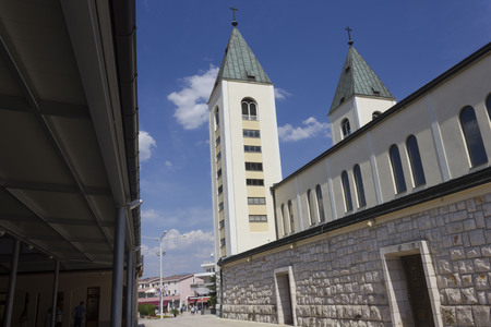 MEDJUGORJE - BOSNIA AND HERZEGOVINA - AUGUST 16 2017:Architectural feature of St.James cathedral bell towers in Medjugorje