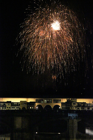 FLORENCE, ITALY - JUNE 24 2013: Fireworks by the historic Ponte Vecchio bridge in Florence, for the patron saint day
