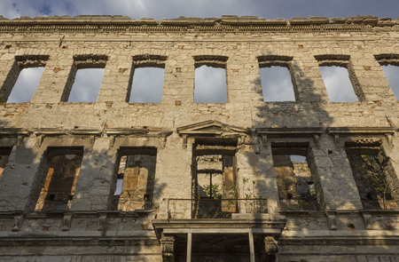 MOSTAR, BOSNIA AND HERZEGOVINA - AUGUST 16 2017: Building ruin in Mostar, after the bombing of the city