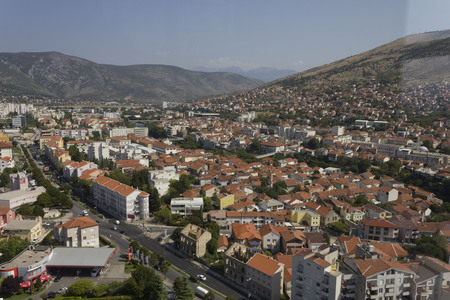 MOSTAR, BOSNIA AND HERZEGOVINA - AUGUST 17 2018: View from the top ofthe city of Mostar, surrounded by mountains
