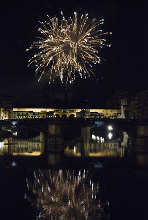 fireworks by the historic Ponte Vecchio bridge in Florence, for the patron saint day