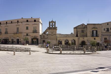 MATERA, ITALY - AUGUST 24 2017: Matera city centre square, facing Materdomini church. Italy