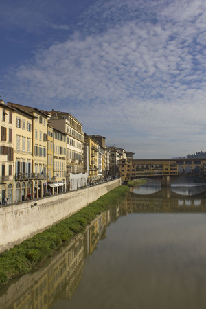 FLORENCE, ITALY - NOVEMBER 22 2015: Arno river and historic Ponte Vecchio bridge in Florence Editorial