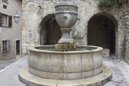 SAINT PAUL DE VENCE, FRANCE - APRIL 24 2017: Big ancient historic fountain in Saint Paul de Vence, France