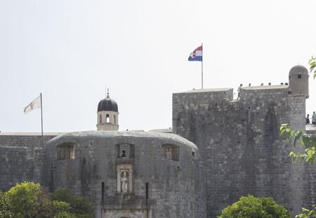DUBROVNIK, CROATIA - AUGUST 22 2017: Dubrovnik surroundig walls with croatian flag