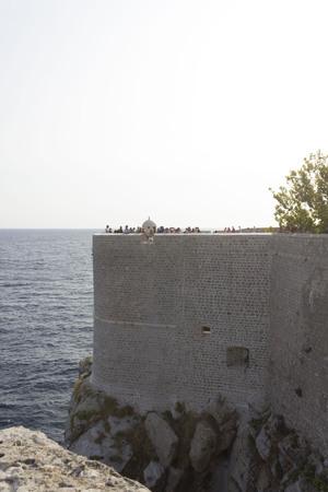 DUBROVNIK, CROATIA - AUGUST 22 2017: Ancient dubrovnik walls overlooking the adriatic sea Editorial