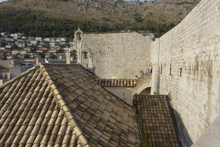 DUBROVNIK, CROATIA - AUGUST 22 2017: Dubrovnik ancient walls and a bell tower