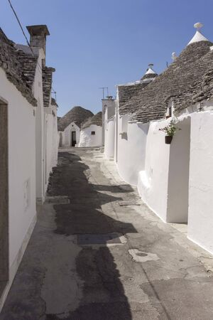 ALBEROBELLO, ITALY - AUGUST 27 2017: Day view of traditional trullo houses in southern Italy