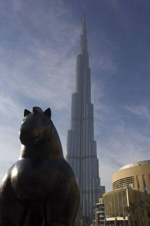 DUBAI, UAE - DECEMBER 26 2017: Horse of Botero in front of Burj Khalifa skyscraper in Dubai