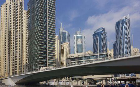 DUBAI, UAE - DECEMBER 27 2017: Dubai Marina district in Dubai, skyscrapers and bridge