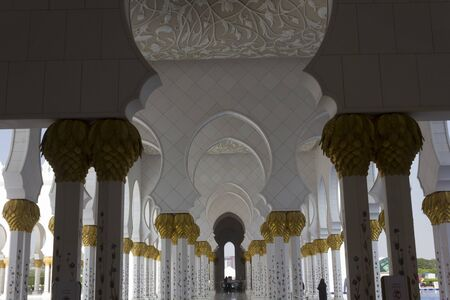 ABU DHABI, UAE - DECEMBER 28 2017: beautiful marble colonnade with cold capital in Sheikh Zayed mosque