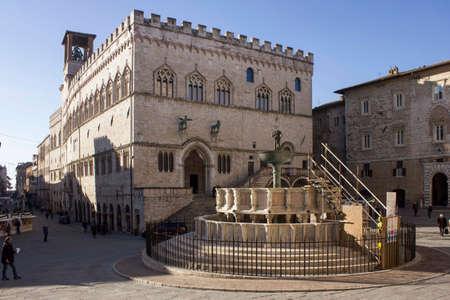 PERUGIA, ITALY - DECEMBER 10 2016: Day view of Fontana Maggiore and Palazzo dei Priori historic buildings in Perugia city, Italy
