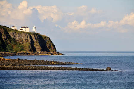 Irish white ighthouse on Antrim Coast, Northern Ireland Stock Photo - 18227864