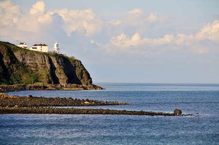 Irish white ighthouse on Antrim Coast, Northern Ireland Stock Photo - 18227864