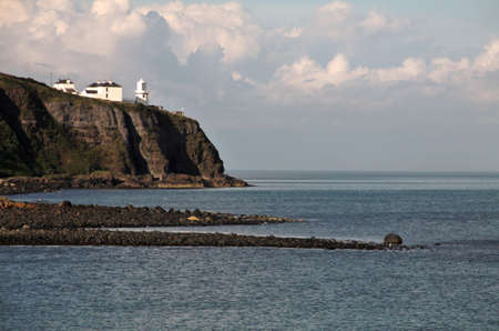 Irish lwhite ighthouse on Antrim Coast, Northern Ireland Stock Photo - 18227862