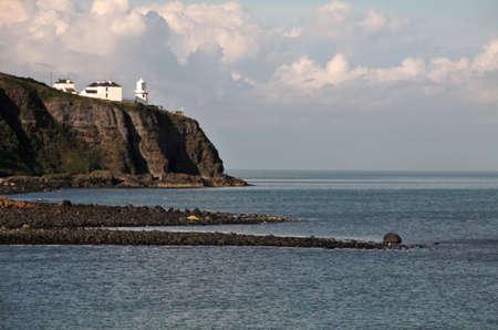 Irish lwhite ighthouse on Antrim Coast, Northern Ireland Stock Photo - 18227862