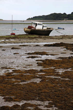 low tide in Northern Ireland with abandoned boat, vertical view Stock Photo - 18227893