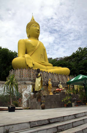 big yellow Buddhas sculpture in Koh Sichang Island, Thailand photo