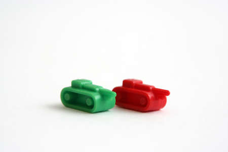 risiko: two lastic toy tanks