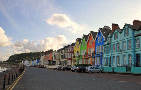 Small village on Antrim coast with coloured houses, Northern Ireland, United Kingdom Archivio Fotografico